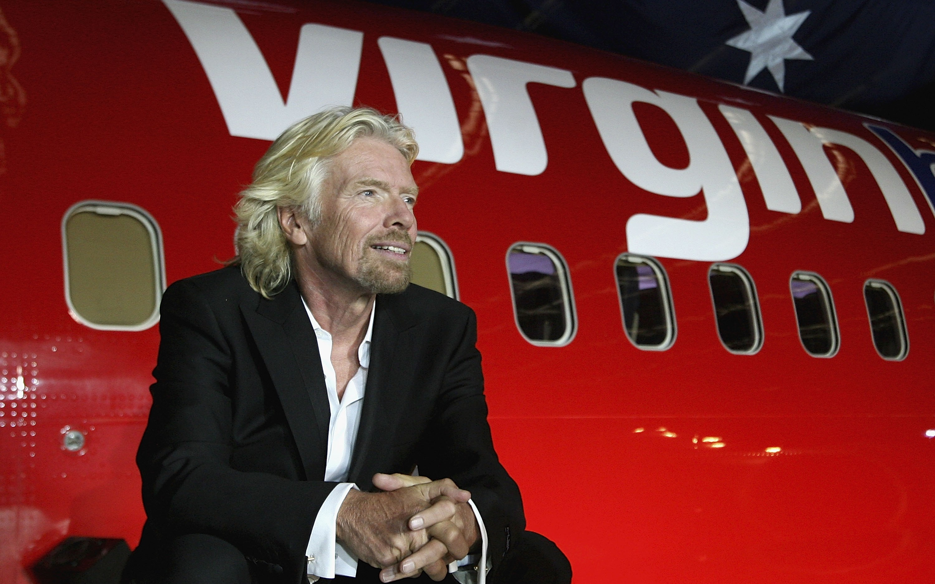 MELBOURNE, AUSTRALIA - SEPTEMBER 12:  Sir Richard Branson celebrates Virgin Blue's 10th Anniversary in Australia at Melbourne Airport on September 12, 2010 in Melbourne, Australia.  (Photo by Robert Prezioso/Getty Images)